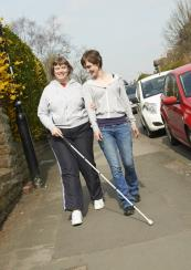 Tracey walking with support