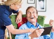 care worker with tablet