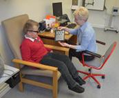 Orthoptic Service in the Eye Department - Senior Orthoptist Julie Lucas with a young patient