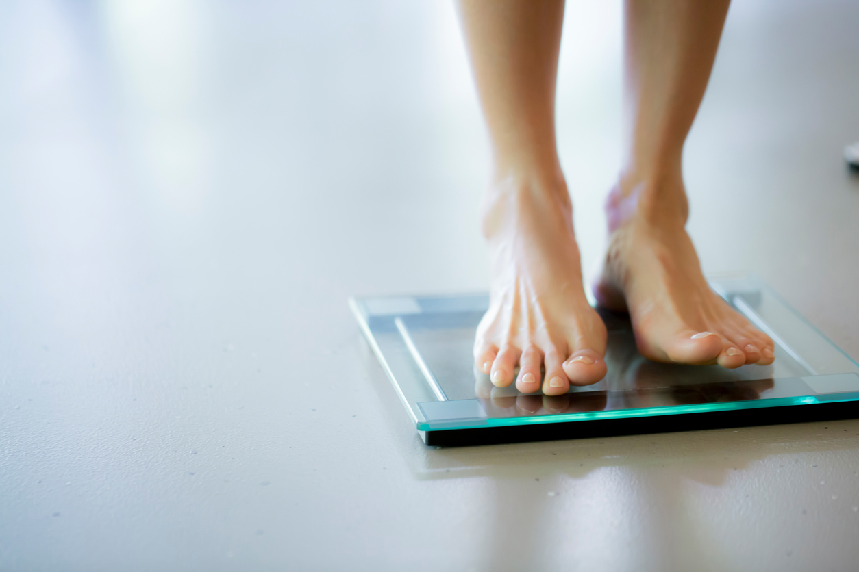 standing on weighing scales