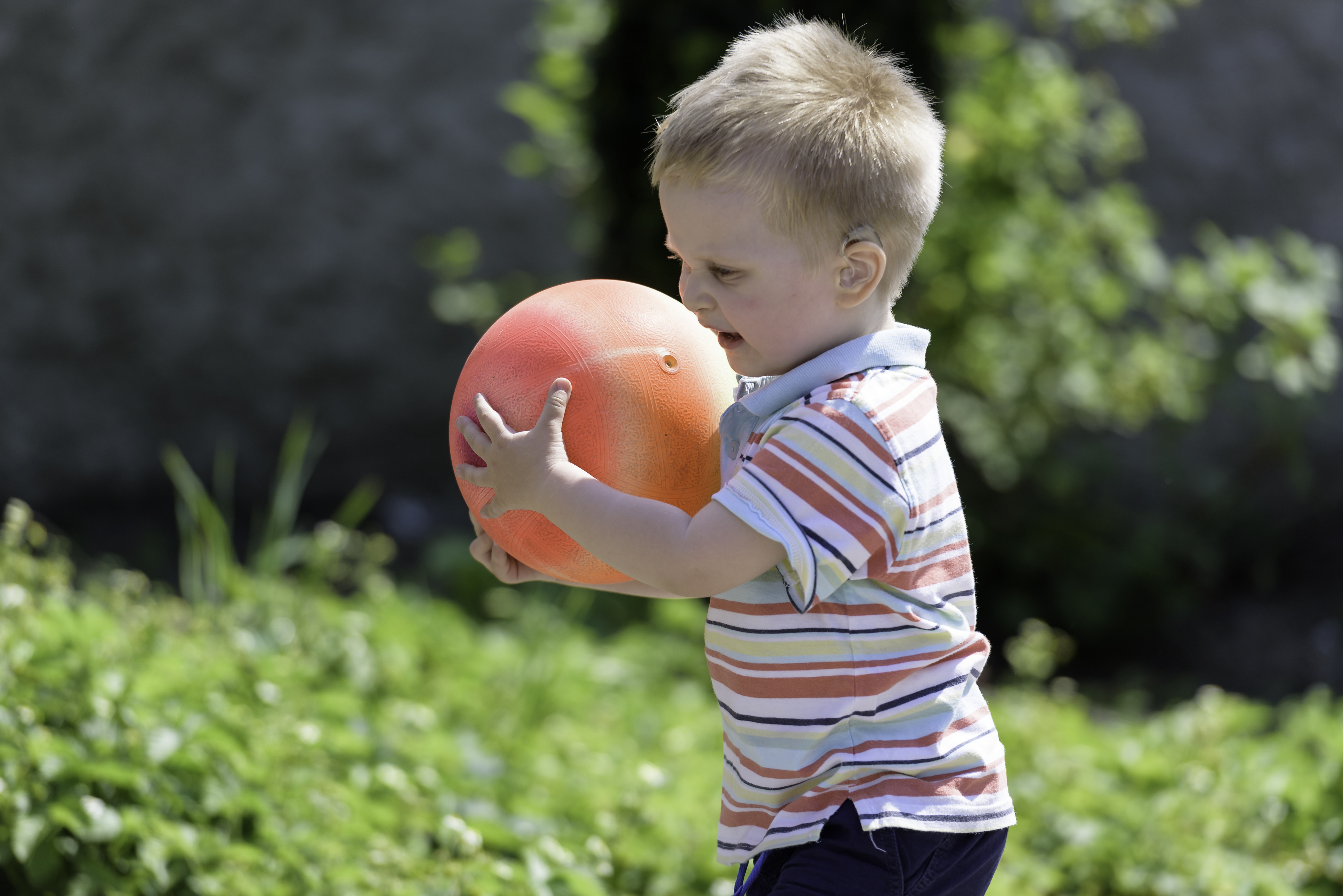 toddler playing with a ball