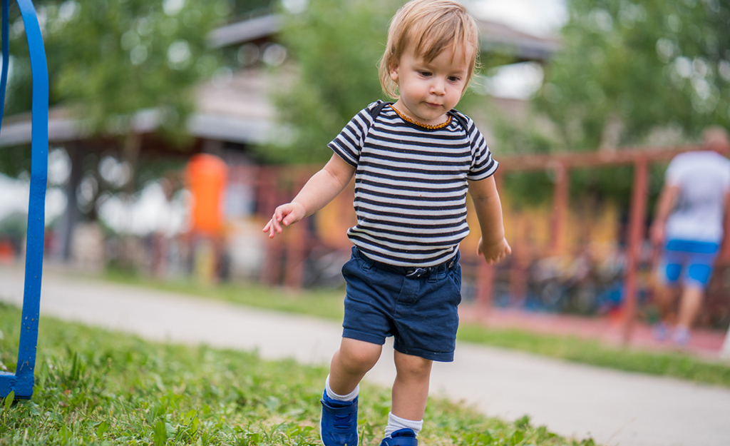 toddler walking in the park