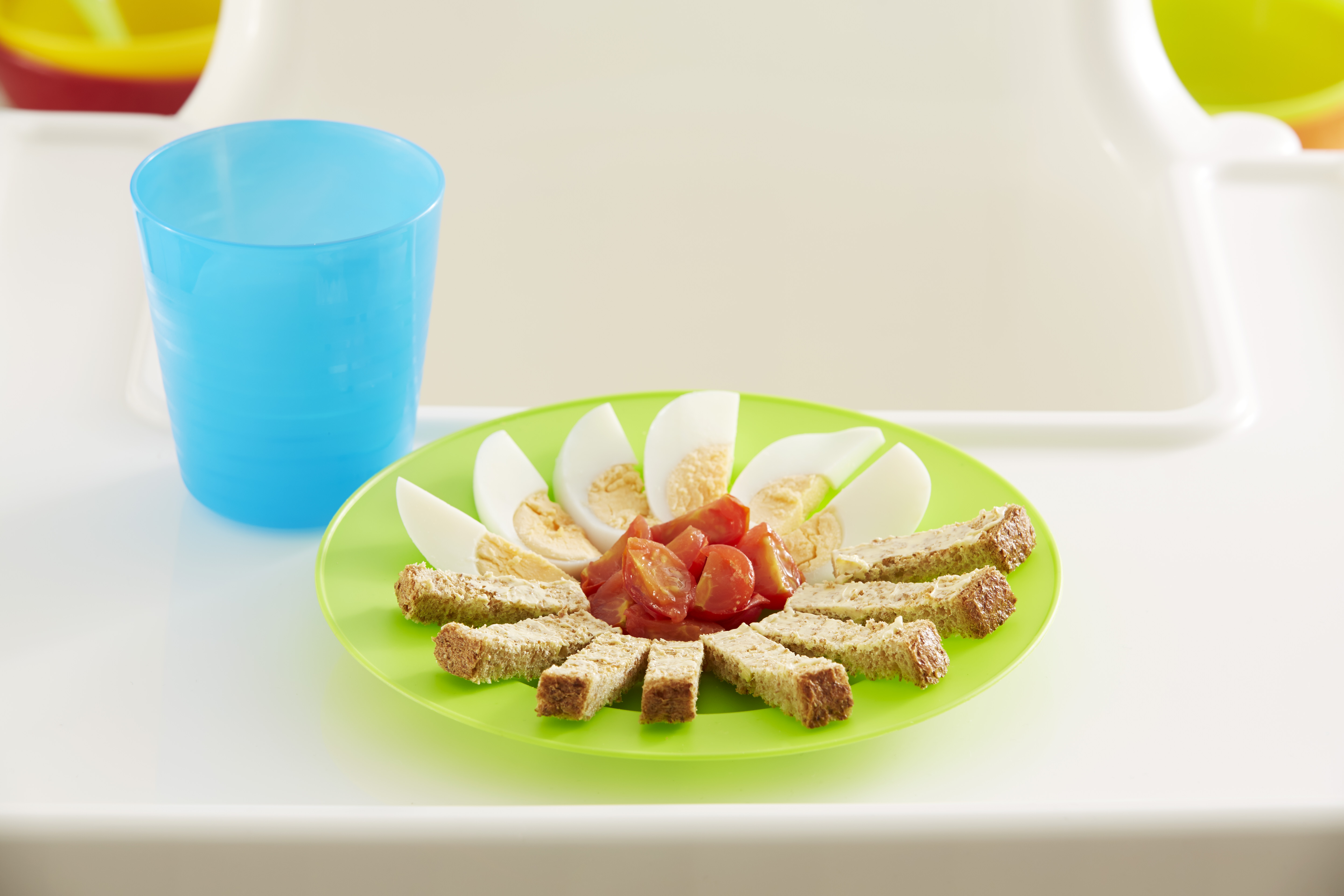 sliced egg, tomato and bread on a plate